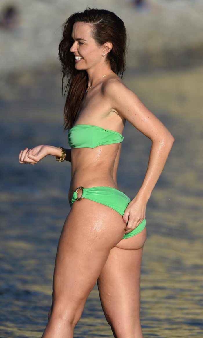 Jennifer Metcalfe in a lime green bikini with her cheeks hanging out