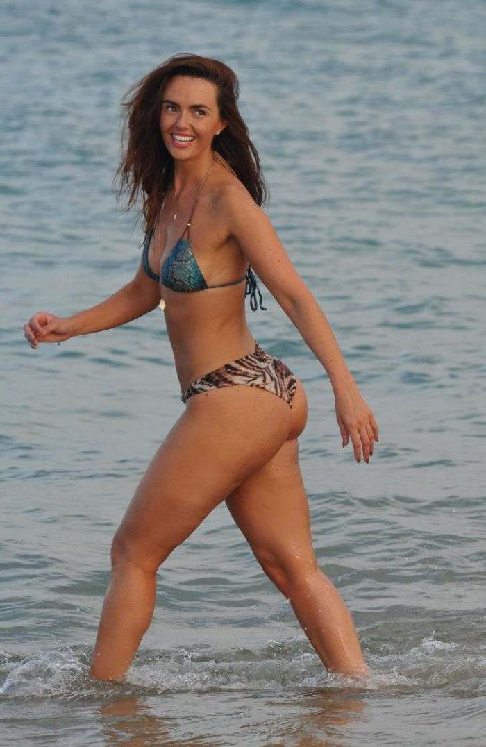 Jennifer Metcalfe in animal print bikini bottom smiling
