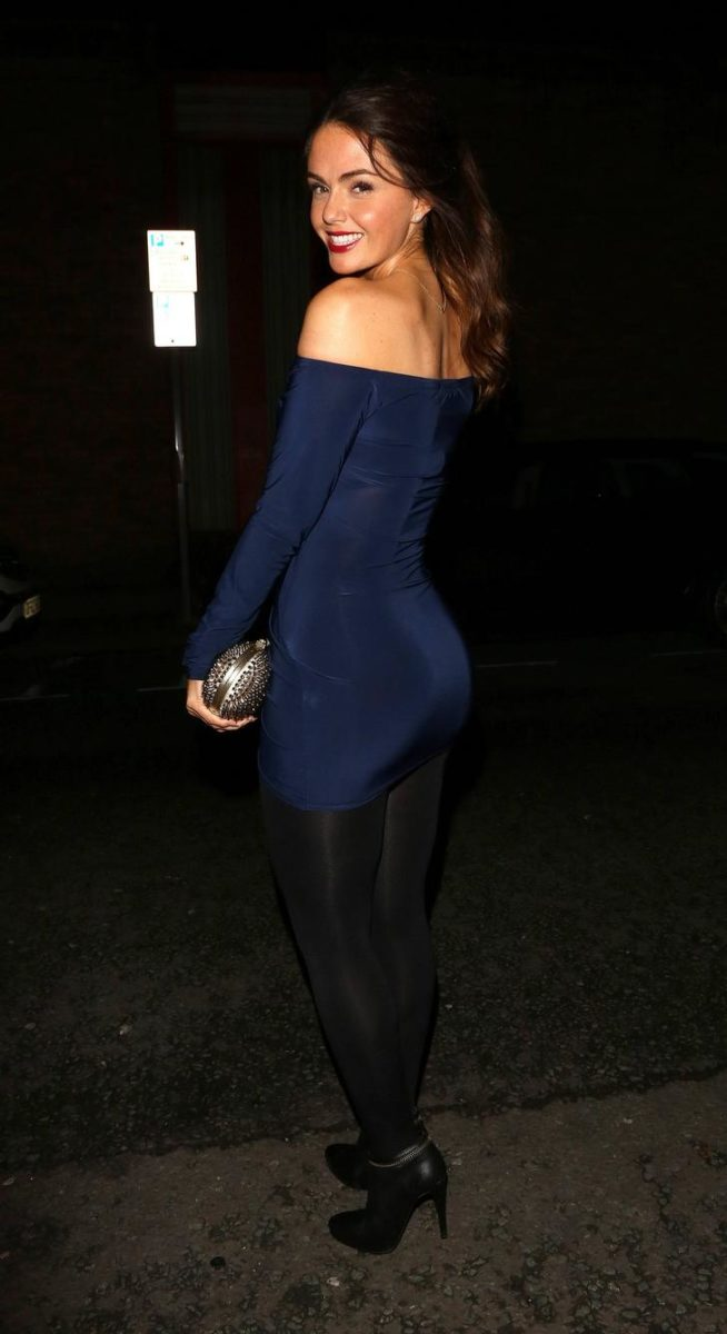Jennifer Metcalfe in dark navy dress and black tights