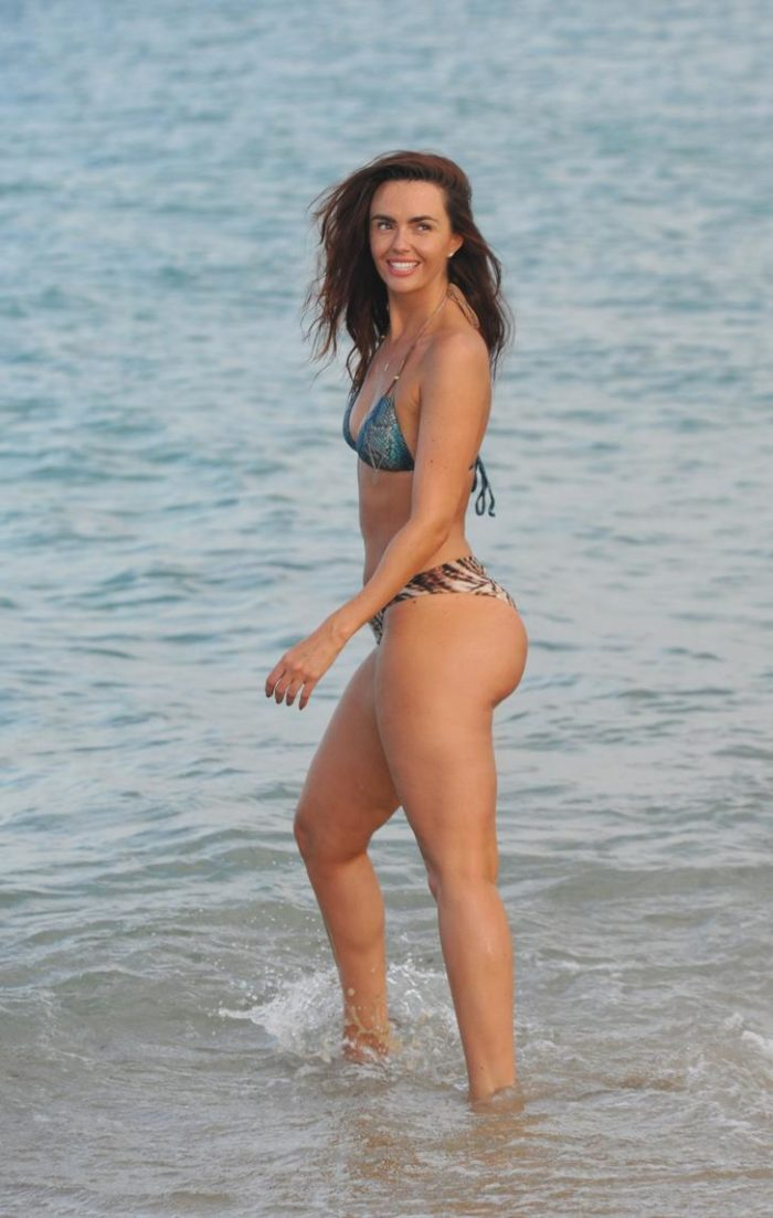 Jennifer Metcalfe walking in water in a bikini