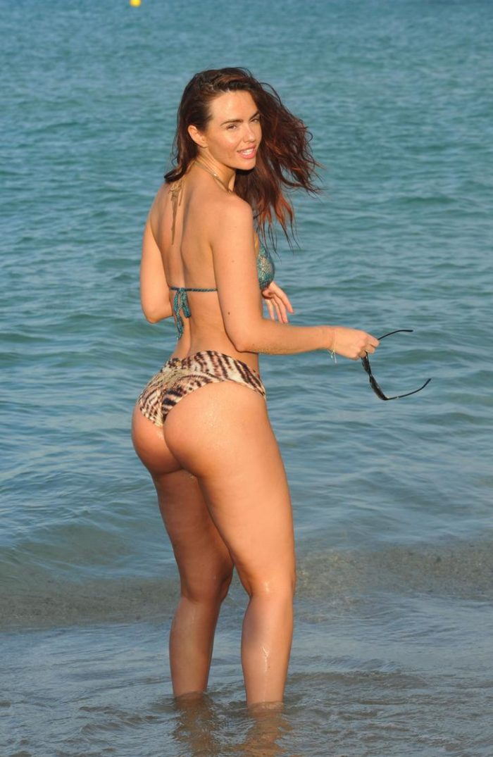 Jennifer Metcalfe wearing bikini and wind blowing in the air