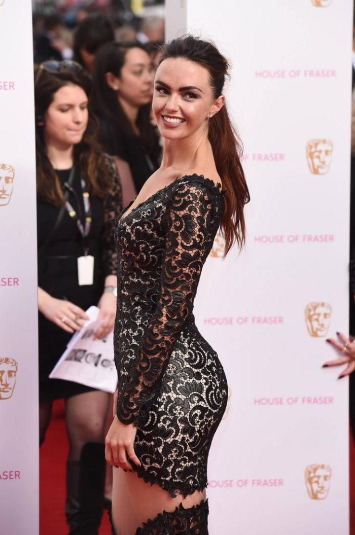 Jennifer Metcalfe with a ponytail in lace black dress and high thighs