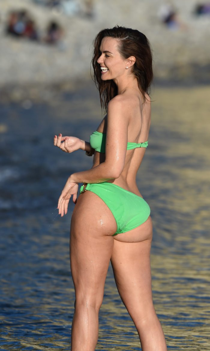 Jennifer in Ibizia in a green bikini in the water