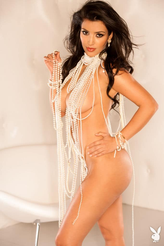 Kardashian with long pearl necklace posing for Playboy