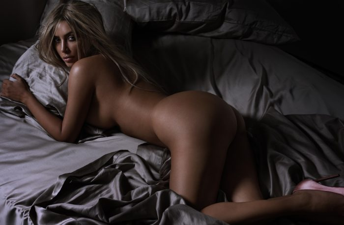 Kim K with blonde hair in sheets for GQ magazine