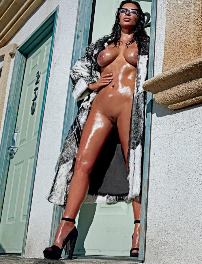 Kim Kardashian in heels with jackets on and no clothes underneath for Love magazine