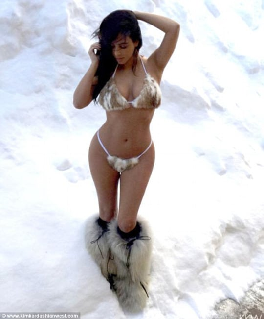 Kim Kardashian in the snow in fur boots and bikini