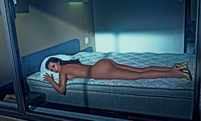 Kim Kardashian laying down naked on bed for Love magazine