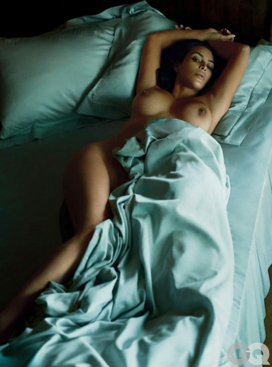 Kim Kardashian laying naked on bed with tits exposed