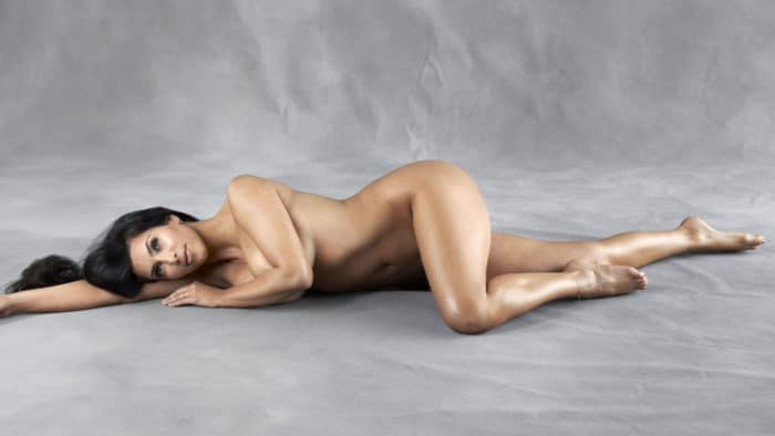 Kim Kardashian laying on her side modeling nude