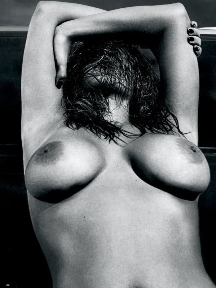 Kim Kardashian topless for Love Magazine with hair in face