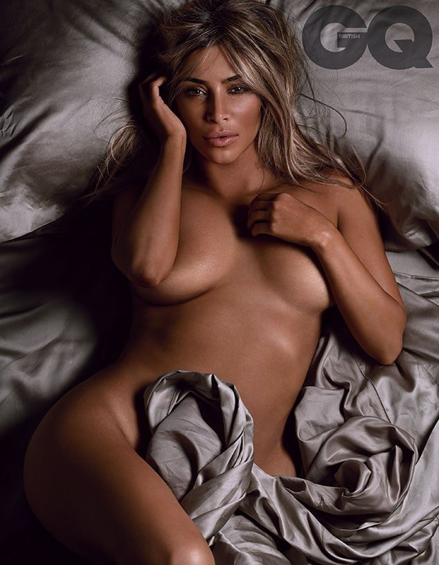 Kim Kardashian with blonde hair topless in bed for GQ cover