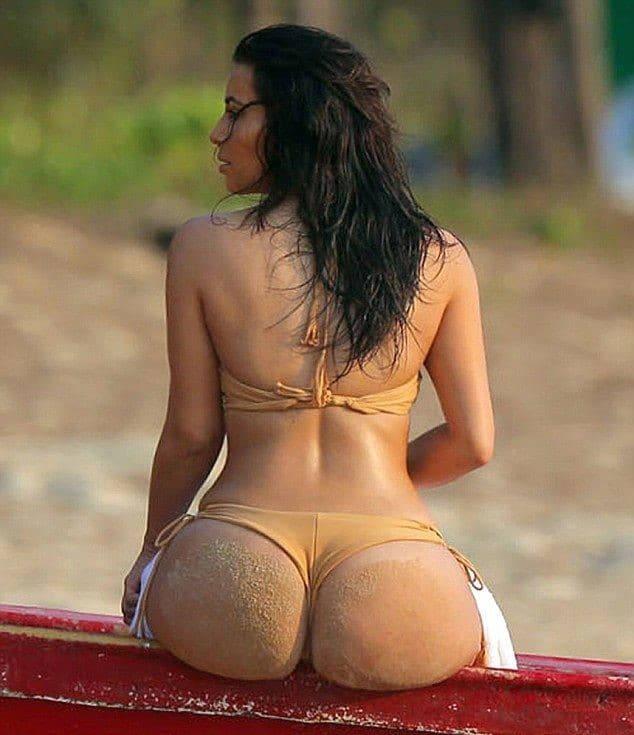 Kim's Booty in nude bikini sitting down