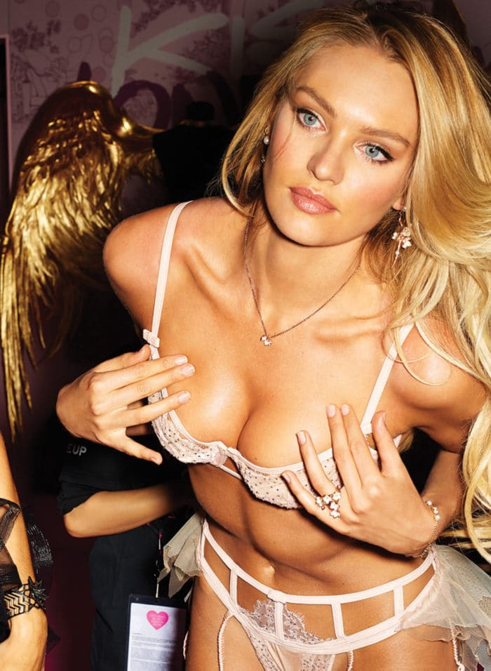 Sexy pic of Candice Swanepoel in lingerie grabbing her boobs
