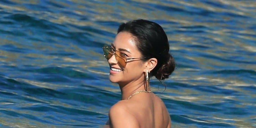 Shay Mitchell topless in Mykonos Greece in the ocean with sunglasses on