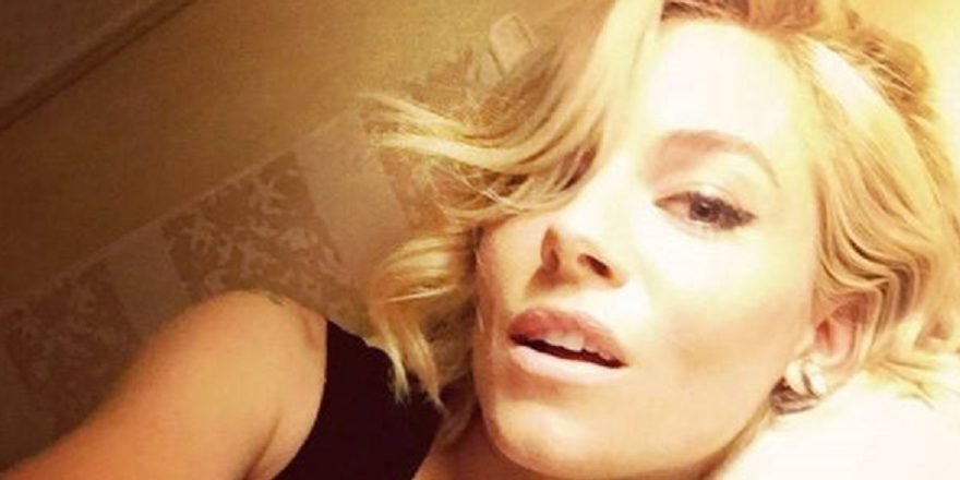 Sienna Miller taking a seductive selfie with short hair