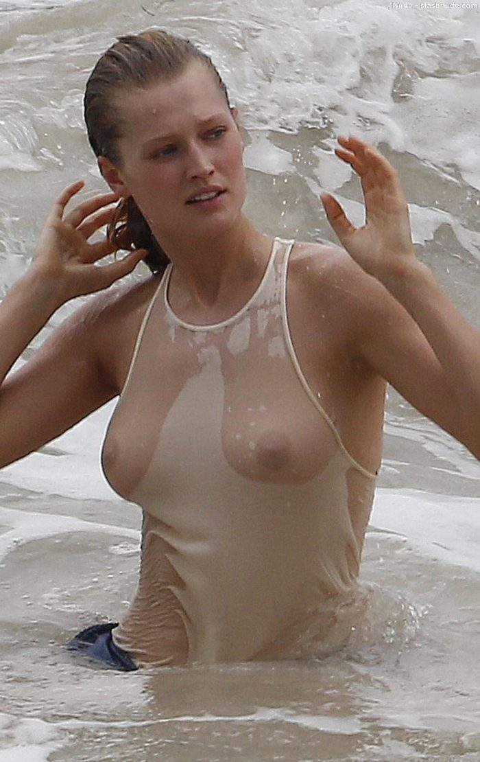 Toni Garrn see through white shirt in the ocean with hair wet