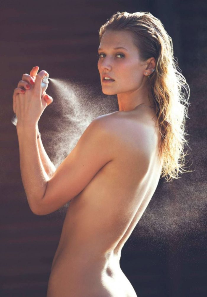 Toni Garrn spraying herslef