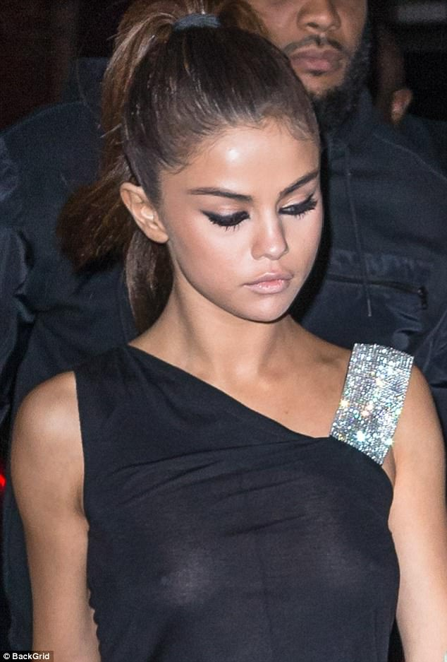 Up close photo of Selena Gomez nipples poking through black dress