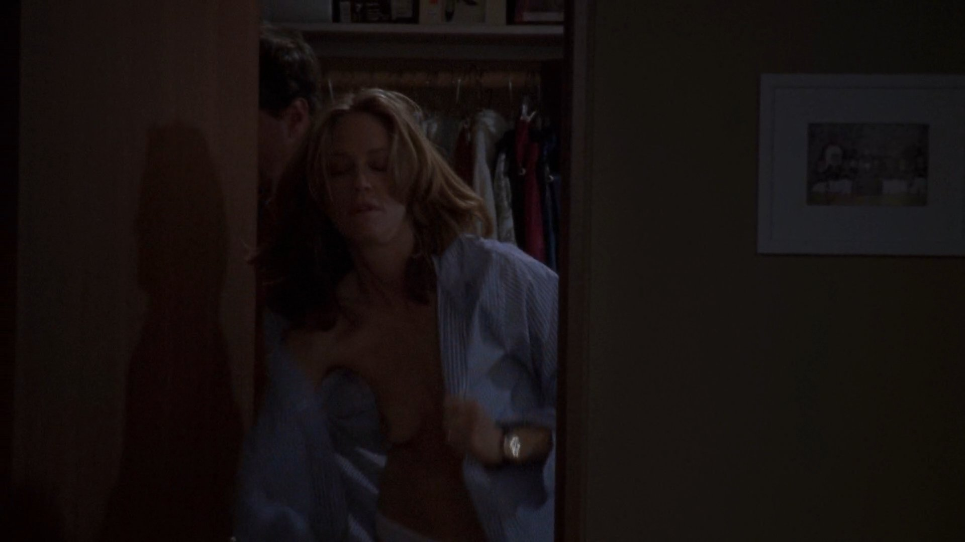 Ally Walker exposing boobs